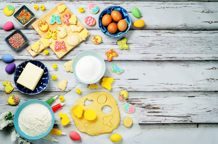 Wood background with Sugar Easter cookies and ingredients for baking. toning. selective focus
