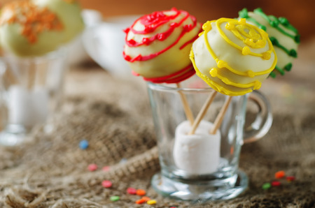 White chocolate Cake pops on a dark wood background. toning. selective focus