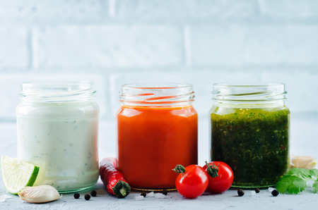 Variation of sauces for meat, poultry or fish. Tomato Chili, Cilantro Parsley Garlic Chili and Greek yogurt Lime Cilantro sauces