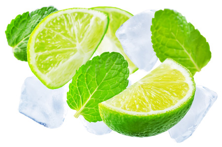 Flying Limes with ices and mint leaves on a white background. tinting. selective focus Stock Photo