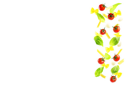 Flying Pasta with Basil, Mozzarella and tomatoes on a white background. copy space Stock Photo