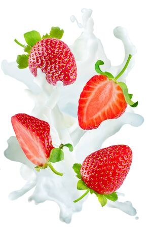 Flying strawberries with a spray of milk isolated. toning. selective focus Banco de Imagens - 99653633
