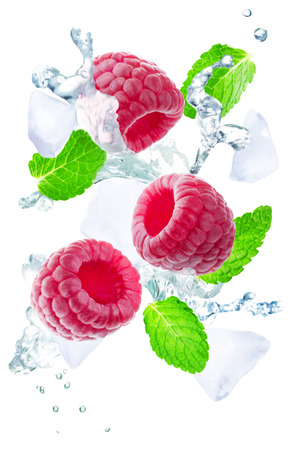 Flying Raspberry with mint leaves and a spray of water isolated. toning. selective focus