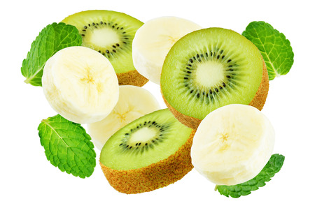 Flying kiwi and banana with mint leaves isolated. toning. selective focus Banco de Imagens