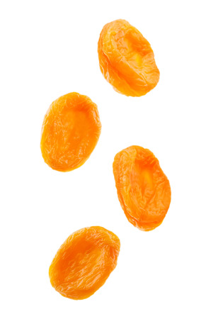 Flying dried apricots isolated. toning. selective focus