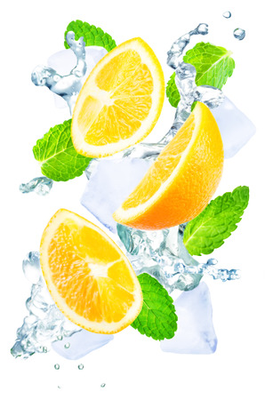 Flying Orange slices water splashes, ices and mint leaves on a white background. tinting. selective focus Stock Photo