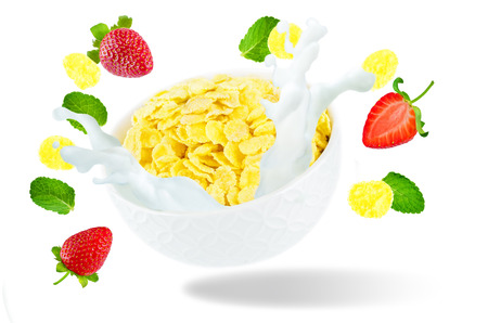 Healthy breakfast with milk, flying corn flakes and strawberries isolated