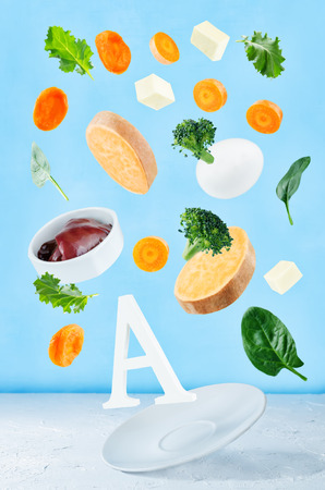 Flying foods rich in vitamin a. Healthy eating Stock fotó