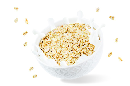 Oat bowl with splash of milk isolated Stock Photo