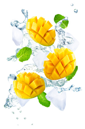 Flying Mango slices with ices and mint leaves on a white background. tinting. selective focus Banque d'images