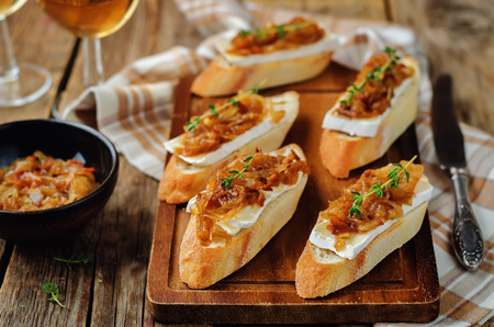 Bacon onion marmalade Brie crostini. toning. selective focus