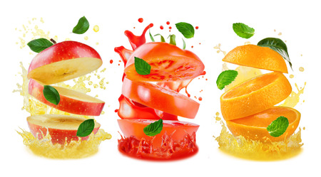 Variation of flying sliced Apple, orange and tomato with juice splashes and flying leaves isolated