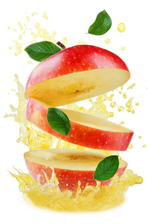 Flying apple with splashes of apple juice and mint isolated