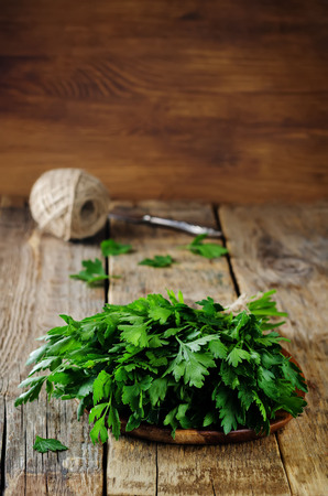 Fresh Parsley Bunch on a wood background. toning. selective focus