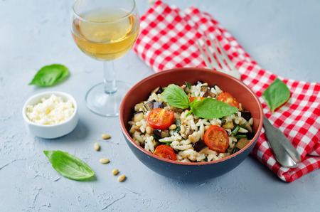 Roasted eggplant and tomato Basil orzo. toning. selective focus Stock Photo