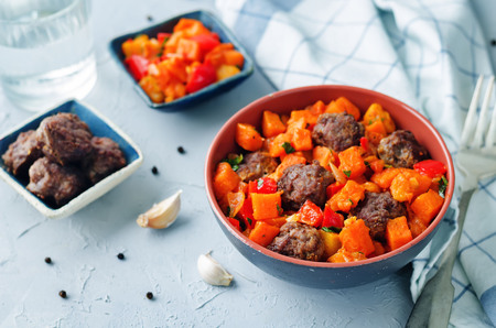 Pumpkin sweet potato Bell pepper stew with meatballs. toning. selective focus Stock Photo