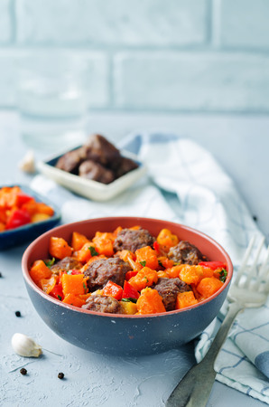 Pumpkin sweet potato Bell pepper stew with meatballs. toning. selective focus Zdjęcie Seryjne - 107951723