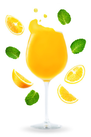 Orange Juice with flying Orange slices and mint leaves isolated