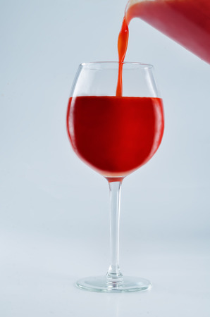 Glass of Tomato juice on a gray background. toning. selective focus 版權商用圖片
