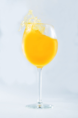 Glass of orange juice on a gray background. toning. selective focus