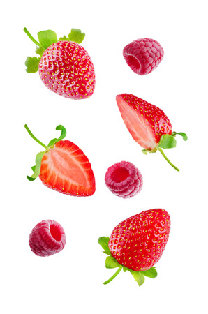 Fresh flying strawberries and raspberries isolated. toning. selective focus Banco de Imagens