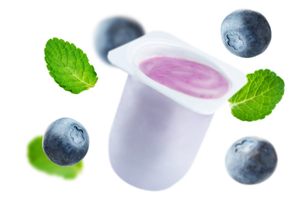 Flying blueberry yogurt with flying blueberries and mint isolated Stock fotó - 108418150