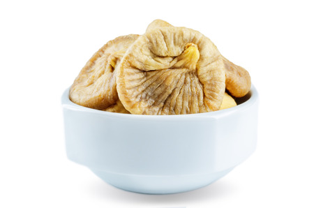 Dried Figs fruits in a bowl isolated. toning. selective focus