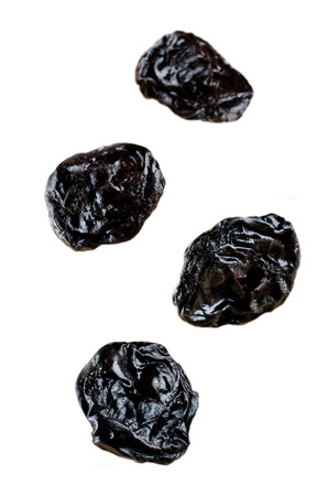Four Flying Prunes fruits isolated. toning. selective focus
