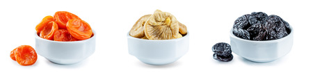 Trio of dried fruits isolated. toning Stockfoto