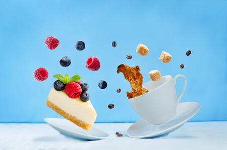 Flying cup of coffee with cheesecake