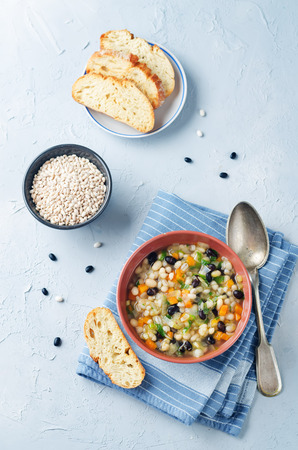 Barley white and black beans vegetable soup Imagens