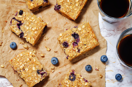 Blueberry Quinoa Oats Breakfast Bars. toning. selective focus Archivio Fotografico - 111011543