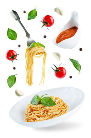 Flying Pasta with Marinara sauce and fresh Basil isolated. toning. selective focus Stock fotó