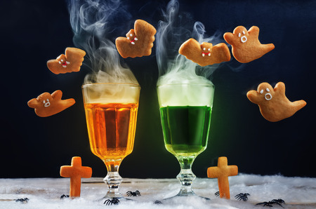 Halloween drinks with flying cookies on a black background. toning. selective focus Stock fotó - 115209562