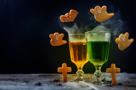 Halloween drinks with flying cookies on a black background. toning. selective focus