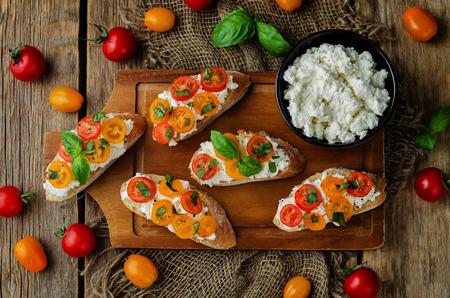 Ricotta tomato Basil bruschetta with fresh tomatoes and Basil leaves. toning. selective focus Stock Photo