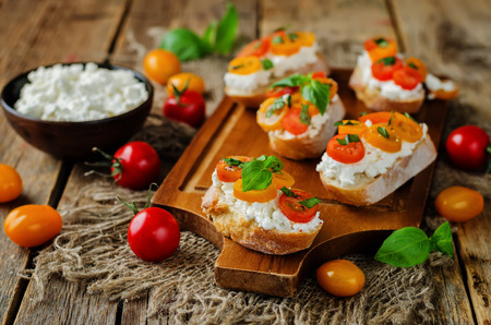 Ricotta tomato Basil bruschetta with fresh tomatoes and Basil leaves. toning. selective focus Stock Photo