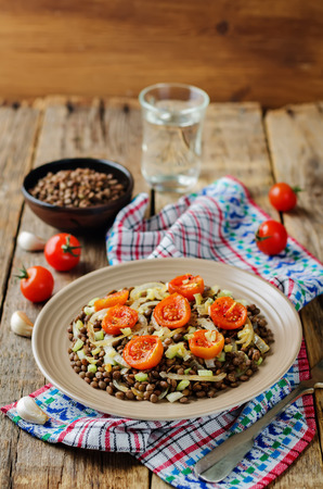 Green Lentil roasted onion and tomato salad. toning. selective focus Stock Photo