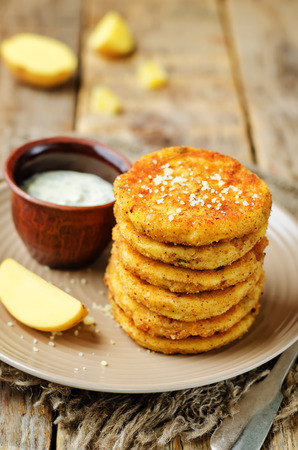 Mashed Potato Cheese Pancakes with Greek Yogurt Dill Sauce. toning. selective focus