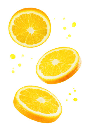 Flying Oranges with juice's spray on a white