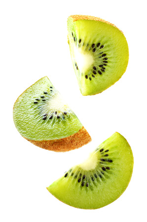 Flying Kiwi slices isolated. tinting. selective focus Imagens