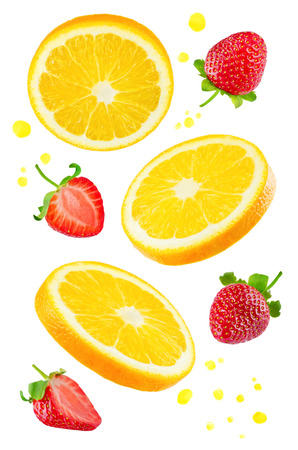 Flying Oranges with strawberries and juices spray on a white
