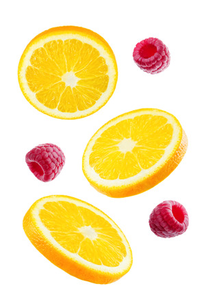 Flying Oranges with raspberries on a white background. tinting. selective focus