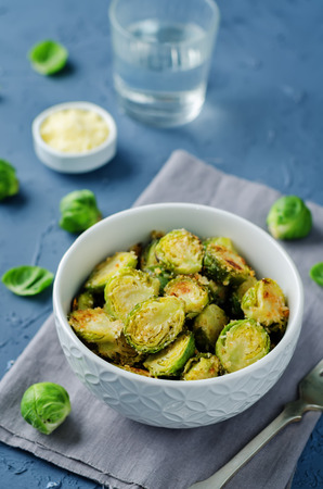 Parmesan Roasted Brussel Sprouts in a bowl. toning. seletive focus