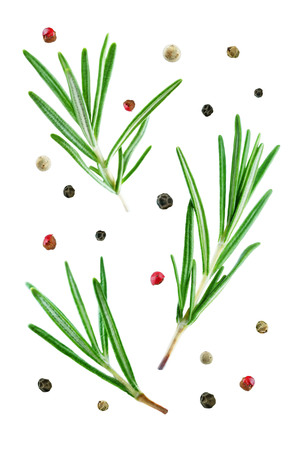 Flying rosemary with pepper isolated. toning 免版税图像
