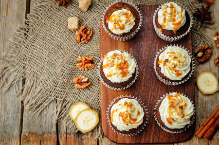 pumpkin pie spices walnuts banana cupcakes with salted caramel and cream cheese frosting. toning. selective Focus Stock Photo