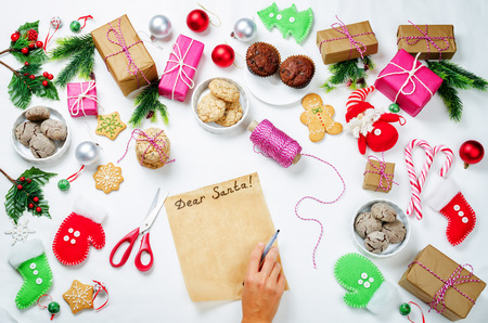 Christmas  with gifts, cookies, Christmas decoration and womans hands Stock Photo