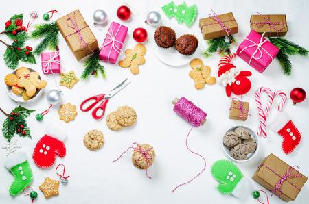 Christmas  with gifts, cookies, Christmas tree branches and christmas balls. Christmas decoration