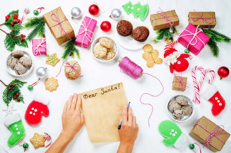 Christmas  with gifts, cookies, Christmas decoration and woman's hands Stock Photo - 119753441