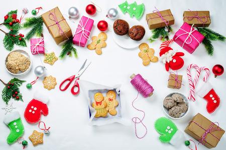 Christmas  with gifts, cookies, Christmas tree branches and christmas balls. Christmas decoration Stock Photo - 119753438